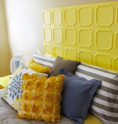 DIY a sunny yellow headboard using styrofoam ceiling tiles.