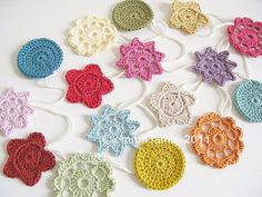 Crochet garland. This would be gorgeous in my craft area or Jillian's room.
