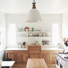 the love the rustic wooden cabinets and all clean white