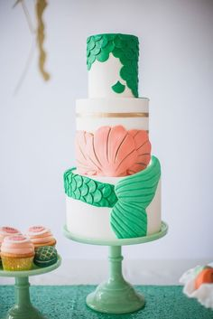 Did you ever think a mermaid cake could look so pretty and classy? This one sure displays a unique beauty different from the standard wedding cake! #weddingcakes #mermaidcake #beachwedding