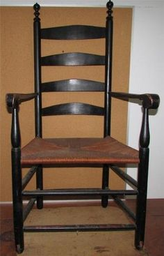 47.5 in high x 17.5 in wide in front. Incredible 1800 four ladder back pieces with incredible finial turnings.  Has original 'invalid' wooden wheels carved into front feet so chair could be moved without getting up. Original black paint.