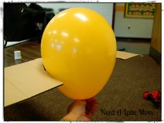 Use cardboard to measure size of balloon so all the balloons are the same size