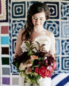 Munster Rose created Kate's bouquet of ranunculus, garden roses, Sahara roses, dahlias, astrantia, and clematis.