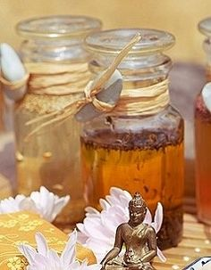 Patchouli Oil (photo only)  Love these little bottles that look like bottles of honey for favor ideas. Especially along with little bottles of honey, which we love and get from a local beekeeper. Note the little Buddha in the vignette. A little bottle of patchouli, a little bottle of honey, and a little Buddha, all on/in a tray to make a nice vignette the guest can keep?