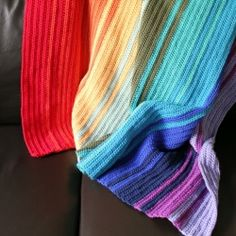 Crochet a rainbow blanket with this easy tutorial....man I REALLY need to learn how to crochet!!