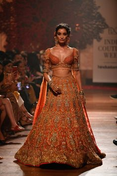 Ever wondered what is Tarun Tahiliani Lehenga Prices? Check out the latest bridal collection along with new lehenga pictures and prices. Indian Bridal Outfits, Indian Bridal Fashion, Indian Bridal Wear, Bride Indian, Indian Weddings, Indian Wear, Indian Gowns Dresses, Indian Fashion Dresses, Dress Indian Style