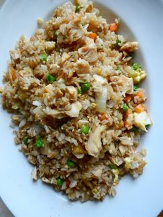 Better-Than-Takeout Fried Rice  4 c rice, prepared 1/2#  chicken breasts, cooked  1 c peas & carrots, frozen 1 white onion, chopped 2 cloves garlic 2 eggs 3 T sesame oil 1/4 c soy sauce Prepare rice according to package instructions to yield 4 c cooked rice. Heat sesame oil in a large skillet on medium heat. Add onion, garlic, peas, and carrots. Stir fry until tender. Crack eggs into pan and scramble, mixing throughout vegetables. Add rice, chicken, and soy sauce to pan.
