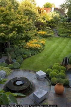 Landscaping Design Ideas - yummy yellows and greens- shaped shubbery