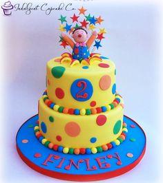 Mr Tumble cake with rainbow layered sponge......