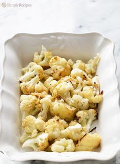 Oven-roasted cauliflower florets, with garlic, lemon, olive oil, and Parmesan cheese. So good! ~ SimplyRecipes.com