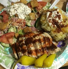 My homemade lemon chicken breasts, fully loaded baked potato and salami and cottage cheese salad