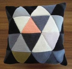 Lovely crocheted triangle cushion