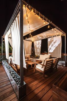 An unused upstairs deck is transformed into a retreat with new seating, lighting and a rain curtain.