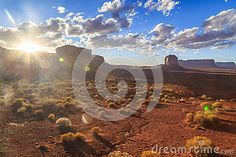 Sun setting behind the mountains of Monument Valley