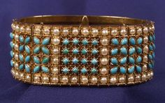 Antique 15kt Gold, Turquoise and Seed Pearl Bracelet, Carlo Giuliano, the hinged panels bezel-set with shaped cabochon turquoise and split seed pearls, granular gold accents.