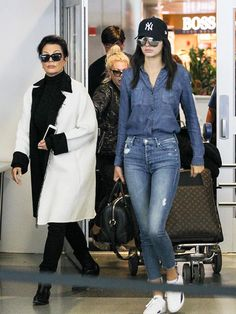 Kendall Jenner arriving at JFK in double denim, May 2015.