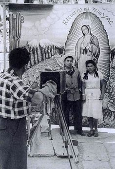 Couple being photographed at Villa de Guadalupe, Mexico City - Nacho Lopez, 1950 www.gotomexico.co.uk www.facebook.com/gotomexico