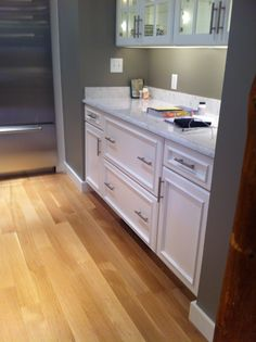 Angel White, applied molding, in Magnolia, MA by Oceanside Cabinets