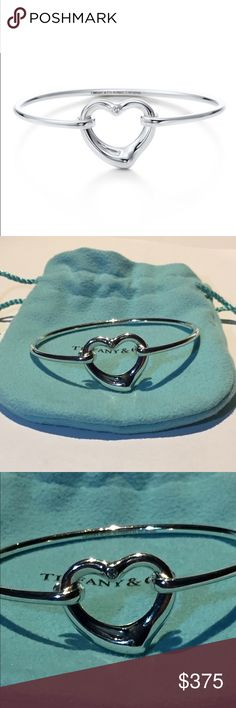 "Tiffany Open Heart Diamond Bangle by Elsa Peretti Tiffany Open Heart Diamond Bangle by Elsa Peretti  Original Retail $625+ Not including taxes.  This is no longer available.  This has been worn a couple time in excellent used condition.  Includes Tiffany Pouch, Box and Ribbon.  ""Elsa Peretti's most celebrated icon. Bangle in sterling silver with a round brilliant diamond. Fits wrists up to 6.25"" in circumference. Carat total weight .03. Original designs copyrighted by Elsa Peretti.""…"