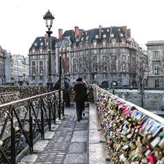 The Pont des Arts bridge in Paris. The padlocks have since been removed, as their weight was compromising the structure. Lovers were known to make a wish on the lock, secure the lock to the bridge, then throw the key into the river.