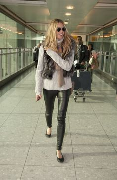 Elle Macpherson is all smiles during her airport visit.