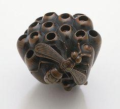 Naito Toyomasa (Japan, 1773 - 1856)   Wasp and Hive, first half of 19th century  Netsuke, Wood with inlays