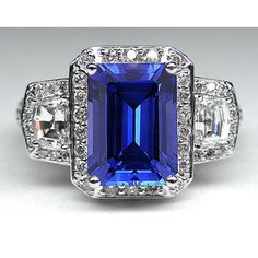 Blue Sapphire Emerald Cut Vintage Halo Ring with Diamond trapezoids side stones