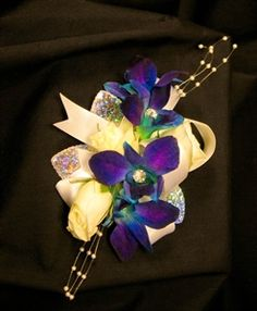 Google Image Result for http://www.simplebouquets.com/flowers/content/images/thumbs/0000191_blue_orchid_corsage_with_crystalsjpg_300.jpeg