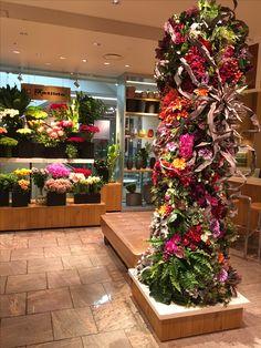ISETAN symbol tower #flower #shop #matilda #中目黒 Isetan, Matilda, Tower, Christmas Tree, Table Decorations, Holiday Decor, Shop, Plants, Wedding