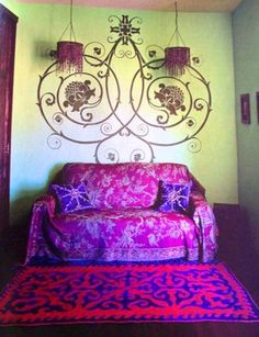 magenta couch and decor