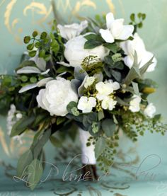 On trend large garden wedding bouquet is so wild, loose, lush and just a little bit whimsical. A gorgeous medium sized posy bouquet featuring a selection of white flowers - peonies, roses, camellia, hydrangea, stephanotis and lashings of foliages creating a rich textural bouquet