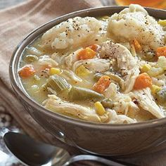 Chicken and Dumpling Soup  1 (10 3/4-oz.) can cream of chicken soup  4 cups chicken broth  4 boneless, skinless chicken breasts, cooked and shredded $  2 (15-oz.) cans mixed vegetables  1 (12-oz.) tube refrigerated biscuits, quartered $  Optional: pepper to taste