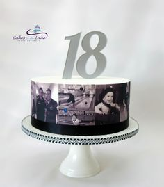 18TH TIMELINE CAKE  It was the weekend for 18th birthday's, and this cake was produced to not only celebrate a young man's 18th birthday but to also give a sneak peek into the last 18 years with a few memories in the form of a black and white edible image strip.  The cake itself was a chocolate mud cake finished in fondant with an acrylic '18' topper from À la Roch.   www.cakesbythelake.com.au