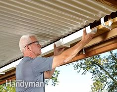 to Build an Under-Deck Roof Catch the runoff from the under-deck roof with gutters and a downspout.Catch the runoff from the under-deck roof with gutters and a downspout. Under Deck Roofing, Under Deck Ceiling, Deck Ceiling Ideas, Second Story Deck, Living Pool, Laying Decking, New Deck, Deck Plans, Roof Deck