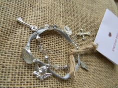 Grey Ribbon Bracelet with Pave Crystal Center and Silver Milagros Approximately 9.25 Inches (23.5 Centimeters) Segundo Milagro gringagordon@gmail.com http://segundomilagro.tumblr.com  #milagro #milagros #spirit #christian #catholic #religious #jewish #blessing #altars #altar #miracle #charm #charmed #blessed #divine #mexico #saints #mexican #sale #gift #custom #folk #art #handmade #artifact #faith #style #shop #protection #custom #cool #god #cross #prayer #chic #fashion #jewelry