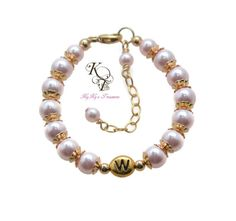 Unique Personalized Flower Girl Bracelet with 14k Gold Filled Flower Bead Caps - Adorable! Choose from over 40 beautiful Swarovski Pearl colors! SHOP NOW: https://www.etsy.com/listing/289040371/gold-flower-girl-bracelet-personalized?ref=shop_home_active_13 #flowergirls #wedding #gold #personalized #littlegirls