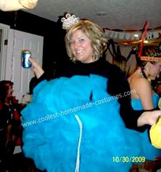 Homemade Loofah Halloween Costume: I got my idea for the Homemade Loofah Halloween Costume from this site.  I took a black tank dress, 30 yards of netting, and tons of safety pins to complete