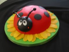 Ladybug cake...I like the sunflower under and how sweet its little face is :)