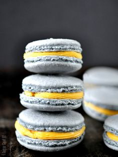 White Chocolate Mango Macarons are white chocolate mango ganache sandwiched between blueberry flavoured and coloured macarons!