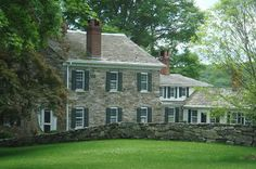 stone and clapboard w/ shutters