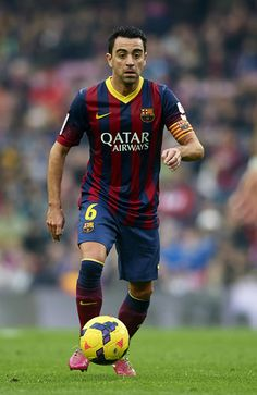 Xavi Hernandez of FC Barcelona runs with the ball during the La Liga match between FC Barcelona and Valencia CF at Camp Nou on February 1, 2014 in Barcelona, Catalonia.