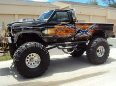 Rebel mud truck. (Image source: http://www.lexnfx.com/redneck-show-truck.php) Somethin bout a truck