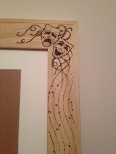 Detail of A3 Obeche photo frame with pyrography design. www.weebly.timmyandme