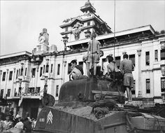 """georgy-konstantinovich-zhukov: """" Young boys, recently liberated from internment by the Japanese in the Philippines, clamor over an American Sherman tank. (US Army) """" University Of Santo Tomas, Kids Climbing, Sherman Tank, Manila Philippines, Young Boys, Us Army, World War Ii, Ww2, Statue Of Liberty"""