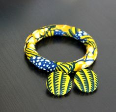 African Fabric-Covered Earring and Bangle Set - Blue and Yellow Seashell. $14.00, via Etsy.