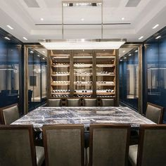 abodeluxury  As you enter this residence located in Greenwich Village, NY. A gracious marble foyer and large gallery lead to an oversized dining room with stunning oil rubbed metal and glass doors which feature a state of the art temperature controlled wine cellar. #wineroom