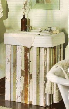 Wood Sink Skirt - perfect idea for my new apartment that has an old fashioned sink - less tacky than fabric skirts!  Could definitely paint the wood in classy colors.