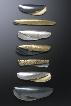 Jane Adam: pod brooches in fine silver or silver and gold bimetal, some with oxidisation, and freshwater pearls.  Average length 70mm
