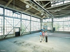 Stock Photo : Business people talking in empty warehouse