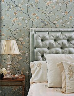 I like how the wallpaper and the headboard blend, maybe not this color, but the concept is cool
